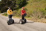 Couple on Segways, each on a Segway, on Angel Island State Park in San Francisco Bay, California, CA. Model released..Photo camari223-70433..Photo copyright Lee Foster, www.fostertravel.com, 510-549-2202, lee@fostertravel.com.