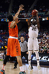 12 March 2015: Notre Dame's Jerian Grant (22) shoots over Miami's James Palmer (left). The Notre Dame Fighting Irish played the University of Miami Hurricanes in an NCAA Division I Men's basketball game at the Greensboro Coliseum in Greensboro, North Carolina in the ACC Men's Basketball Tournament quarterfinal game. Notre Dame won the game 70-63.