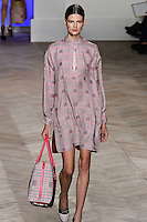 Bette Franke walks the runway in a pink/green glen plaid silk long-sleeve keyhole t-shirt dress, by Tommy Hilfiger for the Tommy Hilfiger Spring 2012 Pop Prep Collection, during Mercedes-Benz Fashion Week Spring 2012.
