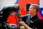 May 5, 2012; Commerce, GA, USA: A crew member for NHRA top fuel dragster Morgan Lucas (not pictured) works on the engine in the pits during qualifying for the Southern Nationals at Atlanta Dragway. Mandatory Credit: Mark J. Rebilas-
