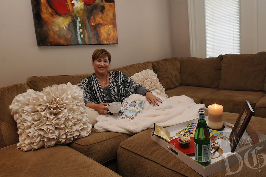 NWA Democrat-Gazette/FLIP PUTTHOFF<br /> Jayshica Amargos in her favorite space, her living room