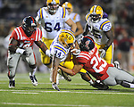 Ole Miss' Cody Prewitt (25) tackles LSU running back Terrence Magee (14) at Vaught-Hemingway Stadium in Oxford, Miss. on Saturday, November 19, 2011.