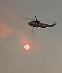 Greeley Hill, California - July 28, 2008- Wildfires Threaten Yosemite National Park .Sun is blocked by Smoke on  Branch Three of the Telegraph Fire late Monday afternoon.  This part of the fire is on the north side of the Merced River and is heading toward the community of Greeley Hill. .This images was an editorial release  through Getty Images..Photo by Al Golub/Getty Images