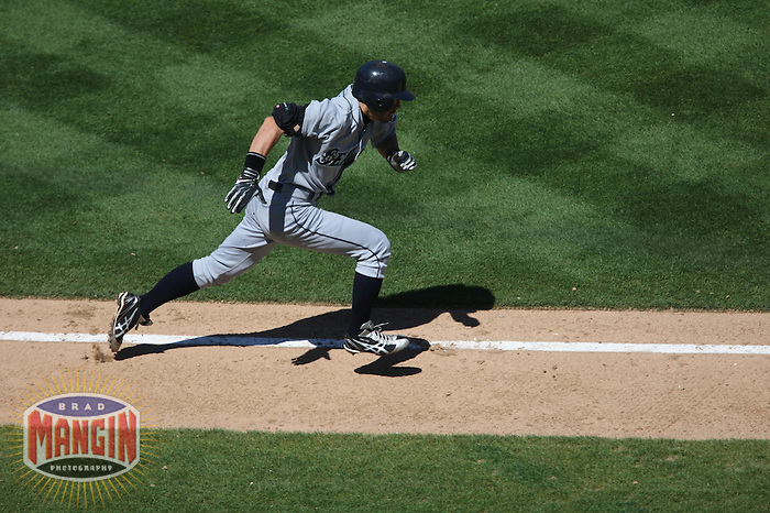 OAKLAND, CA - SEPTEMBER 6:  Ichiro Suzuki #51 of the Seattle Mariners tries to beat out an infield hit as he runs to first base against the Oakland Athletics during the game at the Oakland-Alameda County Coliseum on September 6, 2009 in Oakland, California. Photo by Brad Mangin