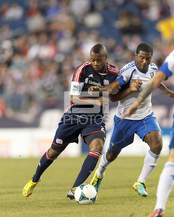 New England Revolution defender Andrew Farrell (2) on the attack as Montreal Impact midfielder Patrice Bernier (8) closely defends. In a Major League Soccer (MLS) match, Montreal Impact (white/blue) defeated the New England Revolution (dark blue), 4-2, at Gillette Stadium on September 8, 2013.