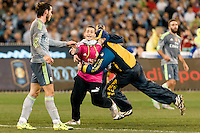 Melbourne, 24 July 2015 - A pitch invader rushes to Gareth Bale of Real Madrid in game three of the International Champions Cup match between Manchester City and Real Madrid at the Melbourne Cricket Ground, Australia. Real Madrid def City 4-1. (Photo Sydney Low / AsteriskImages.com)