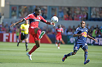 Chicago defender Jalil Anibaba (6) leaps in the air to make the clearance in front of New York midfielder Dane Richards (19).  The Chicago Fire defeated the New York Red Bulls 3-1 at Toyota Park in Bridgeview, IL on June 17, 2012.
