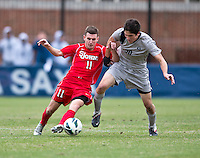 Andy Riemer (20) of Georgetown fights for the ball with Jack Bennett (11) of St. John's during the game at North Kehoe Field in Washington DC. Georgetown defeated St. John's, 2-1, in the Big East conference tournament quarterfinals.