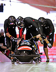 "19 December 2010: Olympic gold medalist Steven Holcomb leads ""Night Train"" and his 4-Man Bobsled team to a gold medal for the USA at the Viessmann FIBT World Cup Championships on Mount Van Hoevenberg in Lake Placid, New York, USA. Mandatory Credit: Ed Wolfstein Photo"