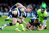 Ollie Devoto of Bath Rugby is tackled to ground. Aviva Premiership match, between Bath Rugby and Sale Sharks on April 23, 2016 at the Recreation Ground in Bath, England. Photo by: Patrick Khachfe / Onside Images
