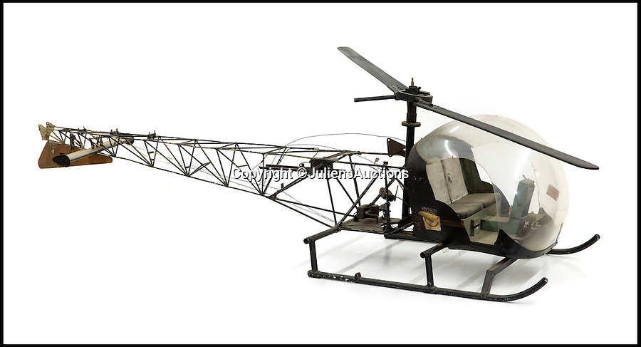 BNPS.co.uk (01202 558833)<br /> Pic: JuliensAuctions/BNPS<br /> <br /> ***Please Use Full Byline***<br /> <br /> The helicopter prop used in the James Bond film, You Only Live Twice. <br /> <br /> A buyer has forked out &pound;10,000 on what might be the ultimate office accessory - the iconic swivel chair used by James Bond's arch nemesis Blofeld in the hit flick You Only Live Twice.<br /> <br /> The bald super-villain sitting in the high-backed leather chair stroking his white lap cat is one of the most recognised images of any Bond film.<br /> <br /> And now the chair's new owner can play at being the evil genius - full name Ernst Stavro Blofeld - in the confines of their own office.<br /> <br /> A small model helicopter that was used in You Only Live Twice for the filming of the scene in which Sean Connery takes on a fleet of black choppers while flying a small microlight called Little Nellie sold for &pound;15,000.