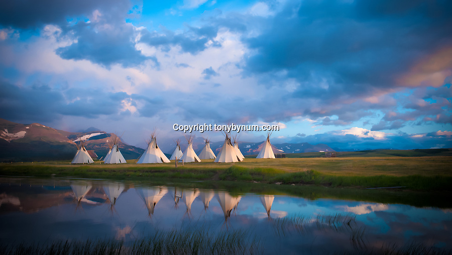 indian tepee village camp on lake near glacier park, blackfeet reservation