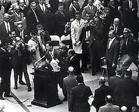 Mario Savio is pulled off the microphone at U.C. Berkeley 1966 Charter Day.(copyright 1966 Ron Riesterer}