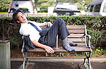 A man takes a snooze on a bench in central Tokyo, Japan on 01 Oct. 2010..Photographer: Robert Gilhooly