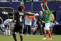 Mexico (MEX) head coach Javier Aguirre gets a Gatorade bath as goalkeeper Guillermo Ochoa (1) and Israel Castro (8) celebrate the victory. Mexico (MEX) defeated the United States (USA) 5-0 during the finals of the CONCACAF Gold Cup at Giants Stadium in East Rutherford, NJ, on July 26, 2009.