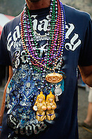 A man displays beads around his neck at the Testicle Festival at the Rock Creek Lodge in Clinton, MT. The beads are typically given to women in hopes that woman will expose her breasts. The Rock Creek Lodge in Clinton, MT, has hosted the annual Testicle Festival since the early 1980s.  The four day festival and party revolves around the consumption of so-called Rocky Mountain Oysters, which are deep-fried bull testicles.