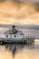 A painterly photo of  Roanoke Marshes Lighthouse at sunrise.