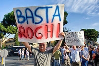Roma 11 Ottobre 2014<br /> Manifestazione degli abitanti del quartiere Tor Sapienza, per protestare contro l&rsquo;illegalit&agrave;, i roghi tossici,i campi rom,  i nuovi centri di accoglienza per immigrati, la prostituzione e ogni altra forma di degrado.<br /> Rome October 11, 2014 <br /> Demostration of the inhabitants of the neighborhood Tor Sapienza to  protest against the lawlessness, the burnings toxic, Roma camps, the new reception centers for immigrants, prostitution and other forms of degradation.