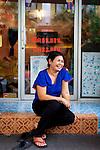 """Thongsuk """"Tip"""" Hansawong, a Thai massage therapaist at her shop on Samsen Soi 2."""