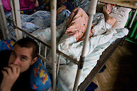 Patients undergo initial treatment at the rehabilitation program for heroin addiction operated by the NGO City Without Drugs in Yekaterinburg, Russia, on Monday, September 24, 2007. Up to 50 people at a time are crammed into a room, handcuffed to their beds, and fed a diet of only bread and water for an initial period of 27 days to ensure they take the treatment seriously and aren't tempted to quit and try again another time. This is followed by a year of community service. The program, which claims an 80% success rate for those who complete the entire course, costs 6000 rubles per month for food and housing, though the rehabilitation itself is free.