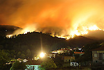 SPAIN, Cuevas del Valle : A forest fire rages outside Cuevas del Valle in the Spanish province of Avila early on July 29, 2009. A bulldozer operator helping to put out a wildfire in the Spanish province of Avila was killed on July 29 after losing control of his machine, a regional government official said. A woman is still missing as firefighters tackle the wildfire, which so far has swept over 300 hectares (750 acres) of land. Last week six firefighters were killed whilst battling fires in Spain that destroyed a total area of nearly 20,000 hectares (50,000 acres). on July 29, 2009. (C) Pedro ARMESTRE