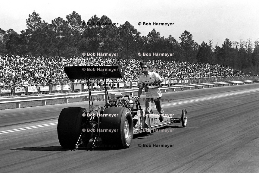 GAINESVILLE, FL - MARCH 14: Shirley Muldowney backs her Top Fuel dragster toward the starting line after completing a burnout during the NHRA Gatornationals at Gainesville Raceway near Gainesville, Florida, on March 14, 1982.
