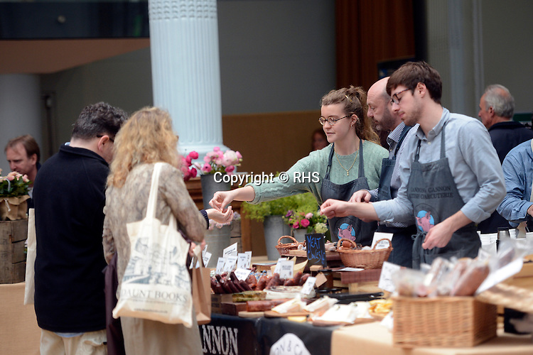 Visitors sample sausage from the Cannon & Cannon stand at an RHS Secret Garden Sunday.