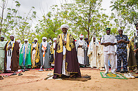 Al Muhammed (Limamin Kebi) Chief Imam performing Salah prayer. Prayer ground in Argungu, Nigeria.