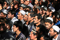 Muslims attend the Friday prayer at Hetian mosque, in Hetian, Xinjiang province, China, on October 13, 2006. The Uyghur people are a Turkic ethnic group living mainly in the Xinjiang Uyghur Autonomous Region of China. Photo by Lucas Schifres/Pictobank