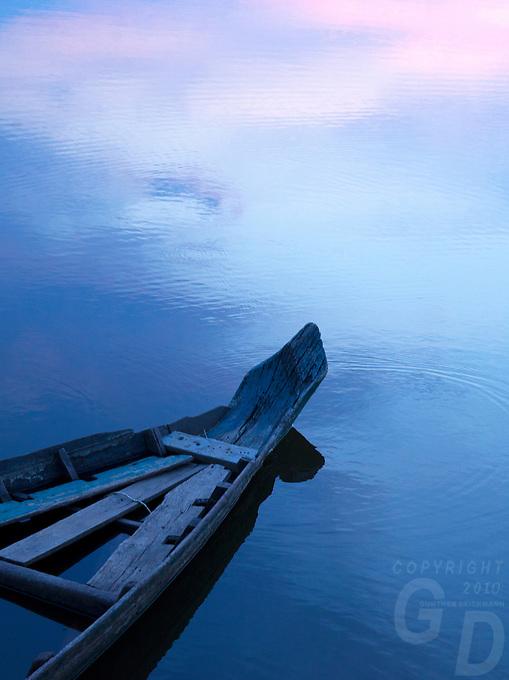 Old wooden boat at the Moat at Angkor Wat, Cambodia