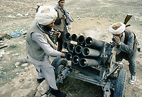 A Taleban charging the fuses of a 12 field missile launcher in the direction of warlord Ahmad Shah Massoud force South of Kabul.