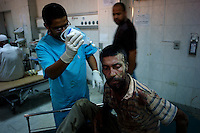 Tripoli, Libya, August 25, 2011.A shellshocked fighter is being treated for a head injury in the hospital I C U, Tripoli central hospital operates under very difficult circumstances, lacking personnel and supplies such as medecines, oxygen and dressings.