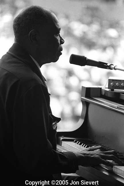 "Sunnyland Slim, Monterey Jazz Festival, 9/20/75.17-13-35.  American blues pianist, who was born in the Mississippi Delta and later moved to Chicago, to contribute to that city's post-war scene as a center for blues music. Chicago's broadcaster and writer, Studs Terkel, said Sunnyland Slim was ""a living piece of our folk history, gallantly and eloquently carrying on in the old tradition."""