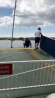 BNPS.co.uk (01202 558833)<br /> Pic: AlanDobson/BNPS<br /> <br /> Beattie tried to push the boat off...<br /> <br /> A dramatic video captures the moment former England striker James Beattie lept into action at the weekend to help a female sailor and her two children trapped under the Sandbanks ferry in Poole.<br /> <br /> The ex-Everton and Rangers striker leapt into action when he heard a woman shout out 'get my children off' as she feared the 25ft boat was about to sink.<br /> <br /> Mr Beattie, 38, and three other passengers jumped a barrier at the end of the small car ferry in Poole and rushed to the edge of a ramp and hauled the crying children to safety.<br /> <br /> Their shaken mother was then helped off the boat.