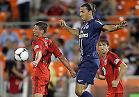 WASHINGTON, DC - July 28, 2012:  Perry Kitchen (23) of DC United shields the ball from Zlatan Ibrahimovic (18) of PSG (Paris Saint-Germain) in an international friendly match at RFK Stadium in Washington DC on July 28. The game ended in a 1-1 tie.