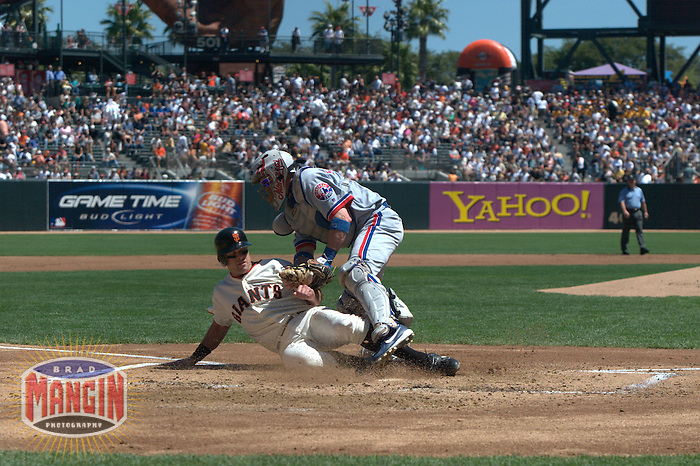 J.T. Snow and Brian Schneider. Montreal Expos vs San Francisco Giants. Game 1 of a doubleheader. San Francisco, CA 8/18/2004 MANDATORY CREDIT: Brad Mangin