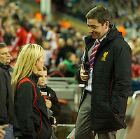 LIVERPOOL, ENGLAND - Thursday, October 4, 2012: Liverpool's team announcer Peter McDowell chats with Scouse Laura before the UEFA Europa League Group A match against Udinese Calcio at Anfield. (Pic by David Rawcliffe/Propaganda)