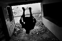Jose Rodriguez, a parkour runner from Plus Parkour team, does a front flip inside an abandoned house during a free running training session in Bogotá, Colombia, 22 February 2016. Parkour, originally developed in France during the late 1980s from military training, is a physical activity, focused on the art of movement and overcoming obstacles in a strictly urban environment. Practitioners of parkour employ running, climbing, jumping, rolling and other movements to pass through any urban area the most efficient way possible.