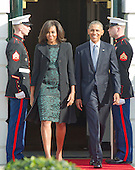 United States President Barack Obama and First Lady Michelle Obama walk out of the Diplomatic entrance prior to hosting an Arrival Ceremony opening the Official Visit of Prime Minister Justin Trudeau of Canada, and Mrs. Sophie Gr&eacute;goire Trudeau on the South Lawn of the White House in Washington, DC on Thursday, March 10, 2016. <br /> Credit: Ron Sachs / CNP