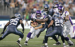 Minnesota Vikings running back Toby Gerhart looks for running room against Seattle Seahawks's Richard Sherman (25), Earl Thomas (29) and Michael Johnson (54) at CenturyLink Field in Seattle, Washington August 20, 2011. The Vikings beat the Seahawks  20-7. ©2011 Jim Bryant Photo. All Rights Reserved.