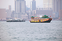Tourism boats in Hong Kong harbour: Phoenix, operated by Watertours, and the Star Ferry company's Shining Star, built in 1964 and recently altered to resemble a 1920s-style ferry, used for the company's harbour tours