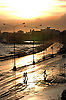 Cuba Trip.Scanned 11/21/2003.Erik Kellar/Staff..A NEW DAY.Wet from a rain shower and crashing waves of the Gulf of Mexico, HavanaÕs famed seaside drive known as the MalecÛn shimmers golden in the rising sun. Erik Kellar/Naples Daily News