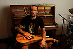 Musician Ben Harper holds a Hawaiin guitar at his studio in Santa Monica, California, U.S. December 7, 2012 ©Jonathan Alcorn/JTA