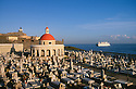 Old San Juan, Puerto Rico: San Juan cemetery, El Morro fortress and lighthouse.with cruise ship approaching San Juan Harbor.