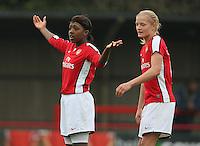 Dan Carter (L) and Katie Chapman of Arsenal - Arsenal Ladies vs Sparta Prague - UEFA Women's Champions League at Boreham Wood FC - 11/11/09 - MANDATORY CREDIT: Gavin Ellis/TGSPHOTO - Self billing applies where appropriate - Tel: 0845 094 6026