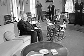 United States President John F. Kennedy (in rocking chair), right, meets with Prime Minister of Australia Robert G. Menzies, left, in the Oval Office of the White House in Washington, DC on September 25, 1962.<br /> Credit: Arnie Sachs / CNP