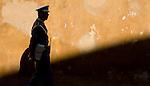 A member of the castle guard walks beside a castle wall in Prague, Czech Republic.