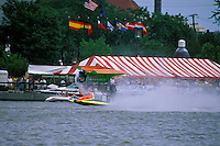 Frame 7: Halfway around the first lap, Wyatt Nelson (#39) blows the boat over crashing back to the water. Nelson was unhurt in the crash. (SST-120 class) Bay City, MI 1998