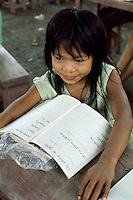 Shipibo Indian girl at school in village on shores of Ucayali River, Peru. Shipibo language belongs to the Panoan family.