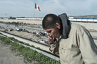 Adan lives en el Bordo where he was deported more than 2 years ago. He's addicted to drugs and makes a living begging in the streets. Tijuana, Mexico. Jan 04, 2015.